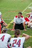 The coach talks to her players at halftime.