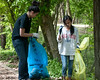 Velycia Antoni, 14 year old student at Northwest HS, and Vionny Amelia, 12 years old student at Roberto Clemente MS, pick up trash along the path bordering the C&O Canal.