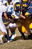 It takes a gang of tacklers to bring down Malik Harris