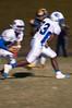 Jonathan Lee carries the ball behind a block from Malik Harris.