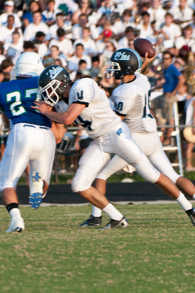 Zac Morton of Whitman throws a block giving Kevin McGowan time to throw.
