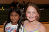 Alison Ramos (8 years old) and Angela Thompson (7 years old) are having fun.