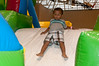 Samuel Ramos (2 years old) launches himself down the slide.
