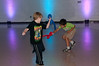 Brady BcBride (6 years old) and Ronit Dasvarma (6 years old) use balloon swords in their disco sword dance.