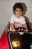 Sammy Lifsey (4 1/2 years old) drives a race car.