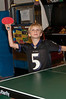 Charles Blessing (7 years old) plays table tennis.