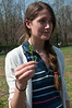 Dea Keen, Farm Manager of the Brickyard Educational section of the organic farm, holds up a sprig of broccoli raab that she picked on the educational portion of the organic farm.