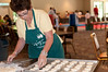 Barbara Abraham arranges the circles of dough that will be the shell for the spinach pies.