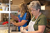 Kati Fannoney, a student at Shady Grove Middle School, and her grandmother Susan Fannoney chop onions for the filling.