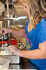 Kati Fannoney, a student at Shady Grove Middle School, chops onions for the filling.