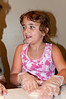 Nine year old Emily Greenberg , a student at Mill Creek ES assembles spinach pies.