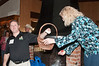 Adam Greenberg , President of the Potomac Chamber of Commerce, draws the winning business card for one of the door p;rizes from the basket held by Jennifer Matheson, Secretary of the Potoamc Chamber of Commerce.
