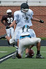 Zachary Snyder kicks a field goal for Whitman's only score.