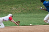 Brett Keenan dives for a grounder, but the ball was too far to reach.