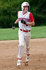 Brett Keenan circles the bases after hitting a homer that gave Wootton a 5-0 lead.