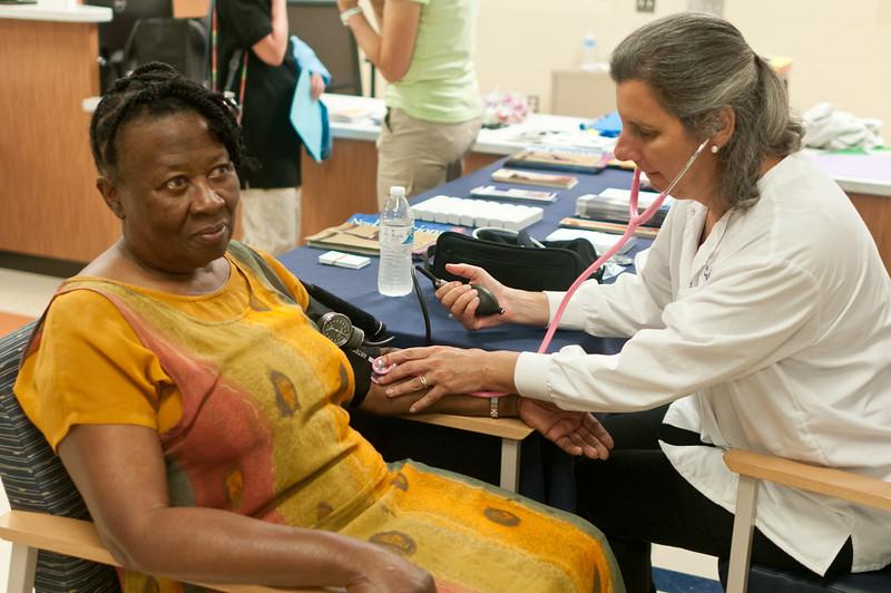Daisy Pottinger gets her blood presure tested by Suburban Hospital RN Jamie Borns.