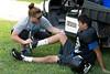 Athletic Trainer Katie Brodka (Metstar Sports Medicine) checks out an injury.