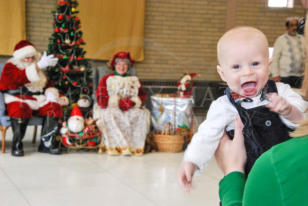 """Five month old, Finley Dunphy happily waits his turn to meet Mr. and Mrs. Claus during the GFWC Agawam Junior Women's Club """"Breakfast with Santa and Mrs. Claus,"""" at the Roberta G. Doering Middle School in Agawam, Sunday. (Kimberly Hatch/Agawam Advertiser News)"""