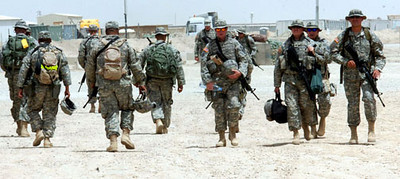 May 28, 2006<br /> Members of the 1016th 2nd Platoon, first section pass the second section during the shift change at the Refuel on the move station Sunday at Camp Cedar II, Iraq.