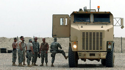 May 15, 2006:<br /> Members of the First Platoon begin preparations for the first Heavy Equipment Transport (HET) <br /> convoy mission.