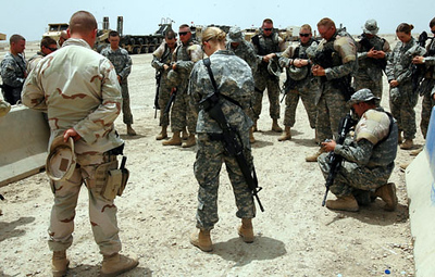 May 15, 2006:<br /> Head of convoy security, Lt. Stephanie Gillespie, of the 812th Quartermaster Co., leads the troops in a prayer prior to departing Camp Cedar.