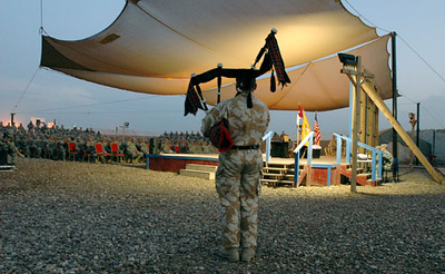 May 6, 2006:<br /> Camp Striker, Baghdad, Iraq. A British soldier plays bagpipes at the beginning of a memorial service for Sgt. Steve Sakoda, of Hilo, HI