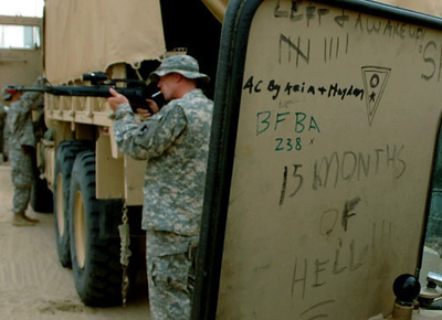 April 30, 2006:<br /> Graffiti on the inside door of a Humvee