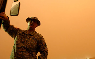 May 10, 2006:<br /> Sgt. Maxwell Teneyck surveys the weather conditions during a sandstorm that delayed our flight from Ali Al-Salem Air base in Kuwait to Iraq for a couple hours.