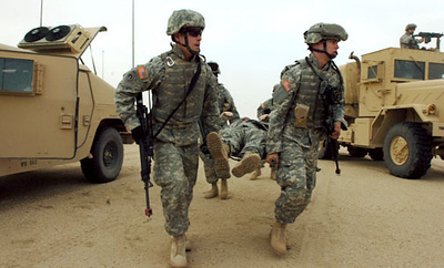 April 30, 2006:<br /> Members of the Third Platoon practice emergency evacuation of a soldier injured during a convoy in Kuwait.
