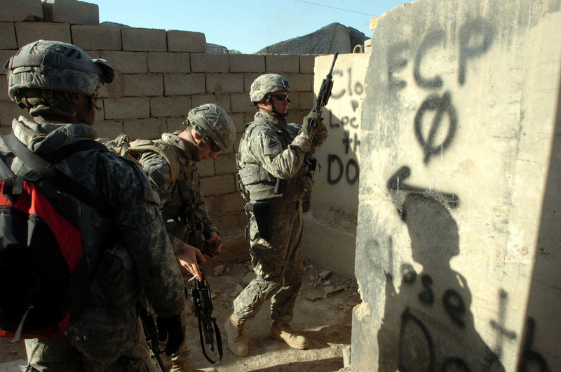 Soldiers prepare to leave Combat Outpost Grant for a morning patrol of the Hay al Adel neighborhood of Ramadi.