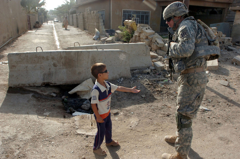 Iraqi children know how to put the pinch on soldiers for candy.
