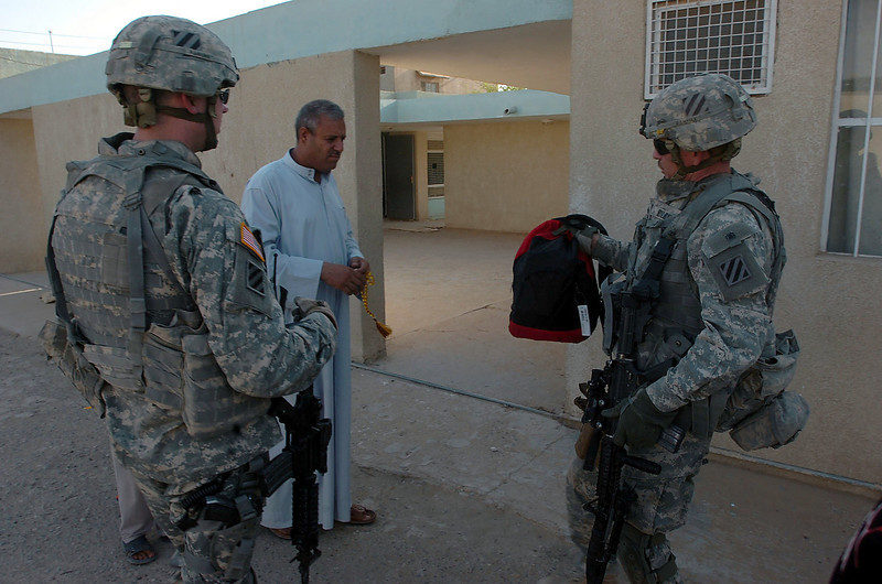 During the early evening patrol the soldiers stop by to donate school supplies to the principal.
