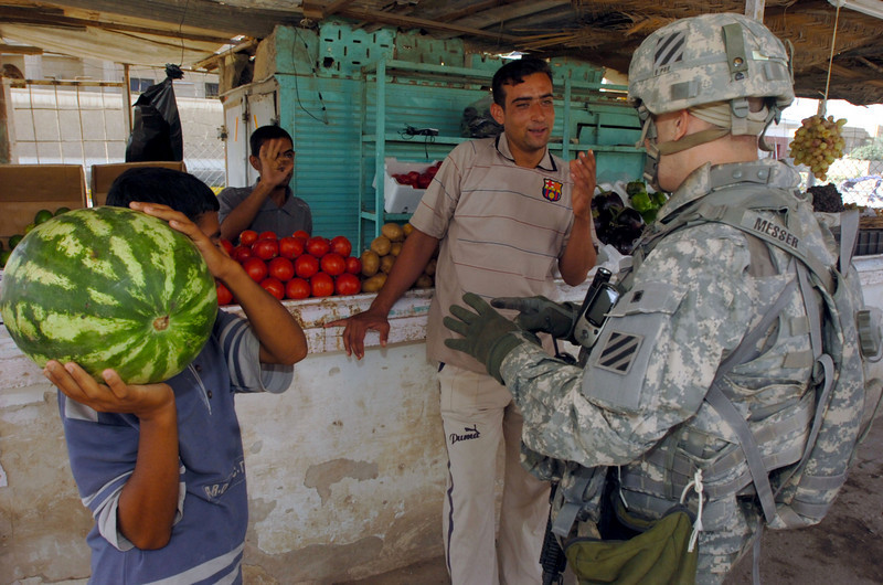 Captain Phil Messer negotiates the price of a watermelon during Saturday's morning patrol.