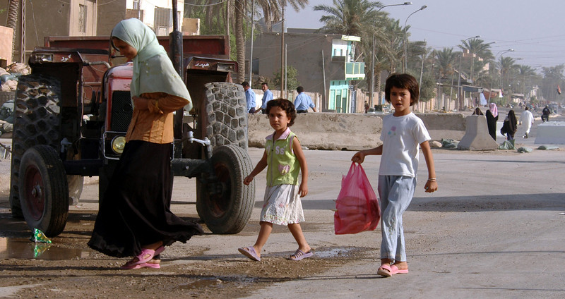 Children go home after going to the local market.
