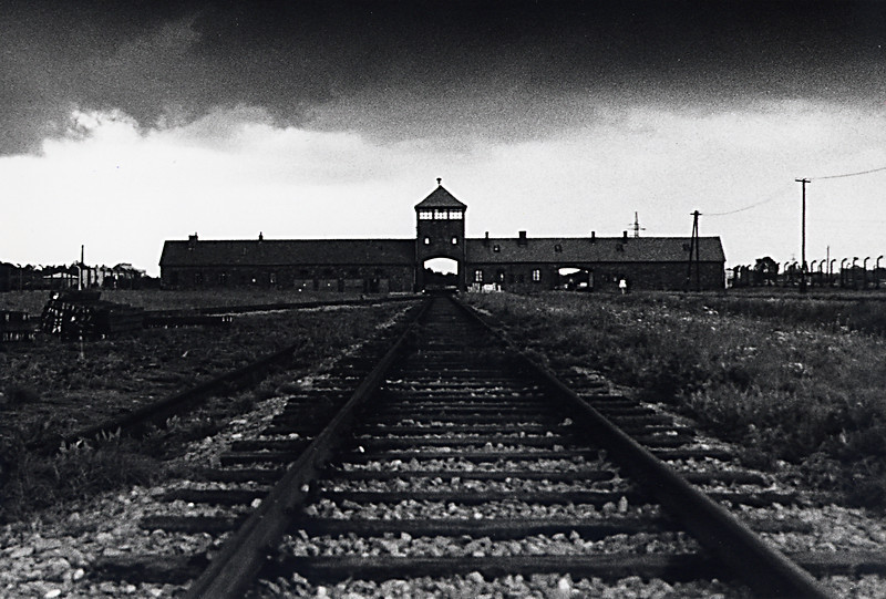 Birkenau, Auschwitz II<br /> <br /> The gaping archway at the entrance to Auschwitz-Birkenau was the last stop on the cattle car for millions. As we drove the 3 kilometers from Oswiecim to this camp, what enfolded before us was the largest death factory in human history. Standing next to the railway lines that were routed here from all parts of Europe, I was astounded at the enormity of the complex. As far as one could see in all directions were remnants of barracks that once held Jewish inmates. During our walk through the camp, a thunderstorm moved quickly into the area. We were caught hundreds of yards from shelter as the skies opened up with lightning, rain and hail. It was a terrifying 30 seconds which seemed like hours as we sprinted for cover. Once safely in an enclosure, I tried to comfort my daughter who had become almost inconsolable with fear. I thought about those Jews trapped here 60 years ago. They were totally exposed and vulnerable as we had just been for a brief moment. They, unfortunately, had no place to run and hide.