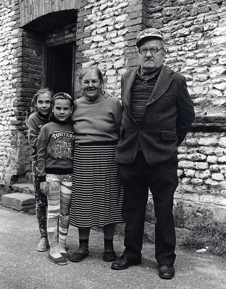 Ul. Kilinskiego, Dabie<br /> <br /> We left Warsaw and drove for two hours, winding our way through an endless series of towns and villages until we reached the outskirts of Dabie. Once in the central square, we were immediately surrounded by a band of inquisitive kids who followed us as we searched for my grandparents' former apartment on ul. Kilinskiego with the help of the map and our Polish interpreter. The gentleman in the photo was a deep well of historical information. During conversation he recalled the Greenfield family and their shoe shop. He also remembered my father's uncle, the photographer, and his little studio. At this point I was very excited to have used the map to find my father's birthplace and to have come across an elderly resident who remembered my grandparents. In the initial euphoria, I never thought to ask permission to go inside the apartment. It was only a short while later that I began to wonder how the current residents got possession of this property which used to belong to my family. Were their relatives willing occupiers of vacated Jewish homes when the ghetto in Dabie was established? Did they collaborate and identify homes where Jews could be found? I never found out. The questions still haunt me.