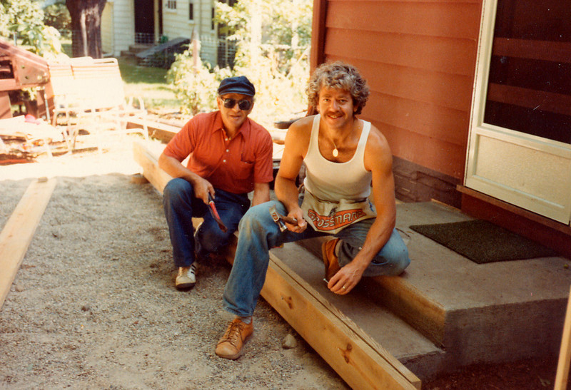 """Joseph and David - building a deck in 1981<br /> <br /> Everlasting Life<br /> <br /> """"May his precious soul be bound up in the bond of everlasting life.""""<br /> Those words are etched at the base of the monument recently dedicated in my father Joseph's memory. I've been thinking a lot about everlasting life during the last 11 months since he died. I've now come to a better understanding of its meaning. In the beginning, I fully expected to feel lost and aching. Expressing similar pained emotions, two Jewish sages, """"Shimon & Garfunkel,"""" better known by their stage names of Paul Simon and Art Garfunkel, composed these lyrics for their soulful song America:<br />  <br /> """"I'm lost and aching and I don't know why, <br /> Counting the cars on the NJ Turnpike""""<br /> <br /> When my journey of mourning began late last January, it was also in New Jersey, and it was also on a highway. But it wasn't the Turnpike, and I wasn't counting cars. I was, however, numbly staring out the window of a small limo as it cruised down Jersey's Garden State Parkway on the way back from the cemetery where my father had just been laid to rest. Although traffic was flowing freely, our driver suddenly exited onto a side road. I turned to ask why the switch. He told me he grew up in New Jersey and loved driving the rural routes whenever he could. At that moment, I pictured my dad leaning over to give him the directions to turn off, just as he often did to me when I was driving, and just as he would have done if he was behind the wheel and the option of a more scenic route presented. I realized in that instant that I would never again take the quiet """"road less traveled"""" without feeling my dad's presence. So, despite the tears of the morning and the turbulence of the previous few months, and unlike the lost and aching souls in the song America, I smiled and turned to continue gazing out the window. Somehow I was happy and at peace.  <br /> <br /> Sitting in synagogue for the daily morning service a """