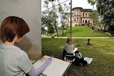 artist hard at work on a water-colour painting of the castle