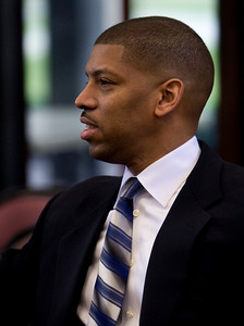 Former NBA player and possible Sacramento Mayoral candidate Kevin Johnson attends a rally for Barack Obama at Sacramento City College on February 1, 2008. Seated next to Johnson is event co-coordinator Hannah Gladstone.
