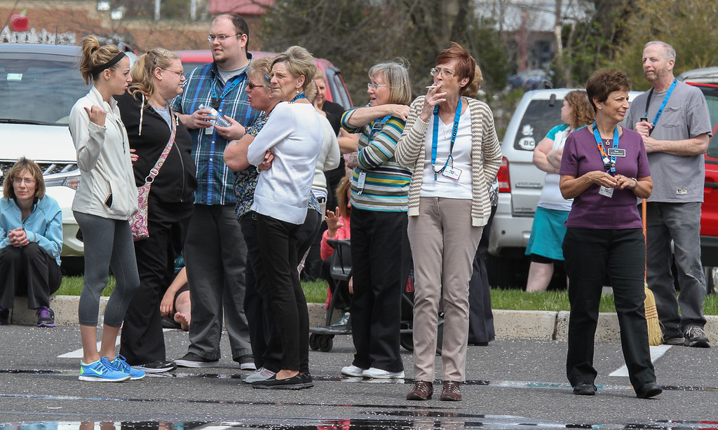 . Kohl\'s employees watch as firefighters extinguish fire at the front of the store. Photo by Kevin Hoffman, The Mercury