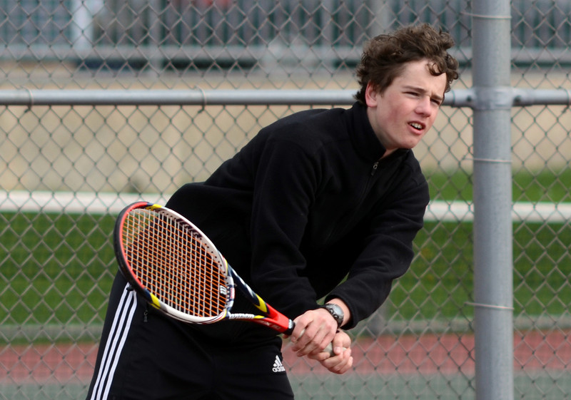 Lockport's Tim Cruz plays doubles with Frank Gabriel, Tuesday, March 27 during a quad tournament at Lockport Township High School. photo for 22nd Century Media by Jean Lachat