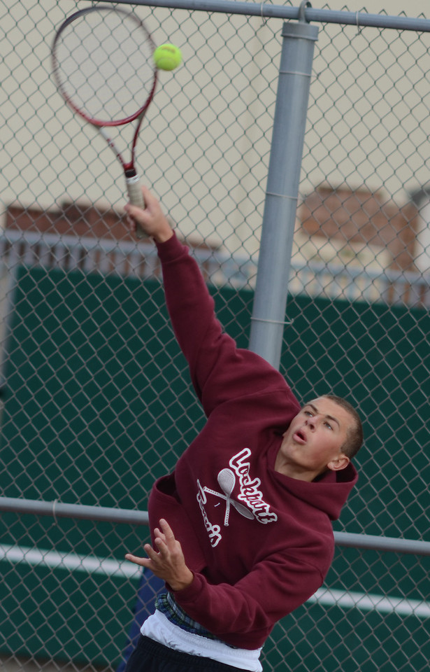 Lockport's Matt Muszynski plays singles, Tuesday, March 27 during a quad tournament at Lockport Township High School. photo for 22nd Century Media by Jean Lachat