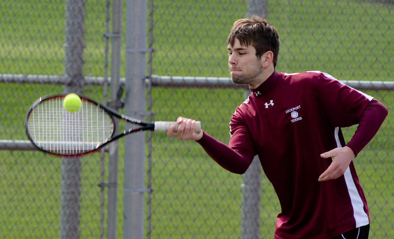 Lockport's Jonathon Kamba plays doubles with Ed Estrella, Tuesday, March 27 during a quad tournament at Lockport Township High School. photo for 22nd Century Media by Jean Lachat