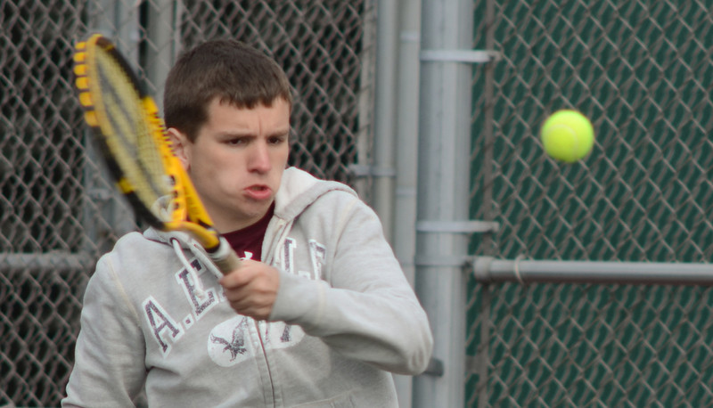 Lockport's Oliver Carroll plays doubles with Jose Martinez, Tuesday, March 27 during a quad tournament at Lockport Township High School. photo for 22nd Century Media by Jean Lachat