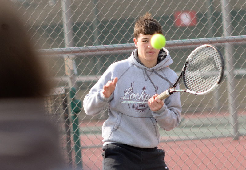 Lockport's John Kalmanek plays doubles with Matt Monte, Tuesday, March 27 during a quad tournament at Lockport Township High School. photo for 22nd Century Media by Jean Lachat