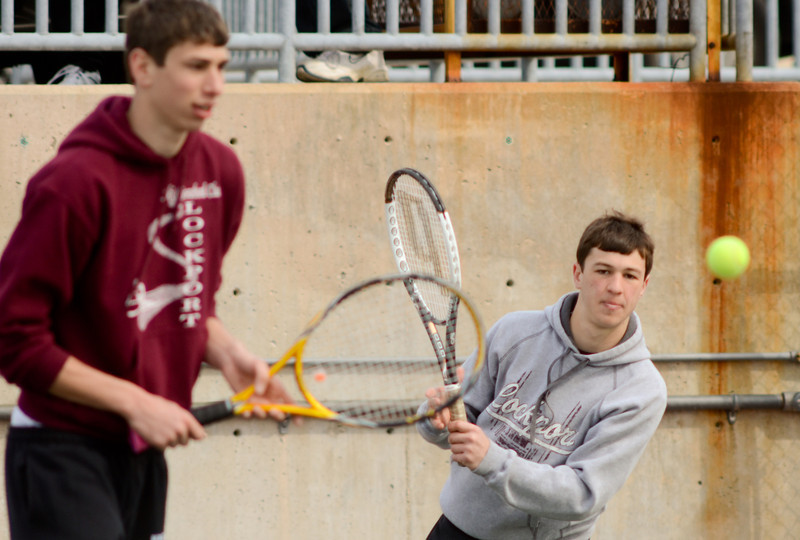 Lockport's Matt Monte, left, plays doubles with John Kalmanek, Tuesday, March 27 during a quad tournament at Lockport Township High School. photo for 22nd Century Media by Jean Lachat