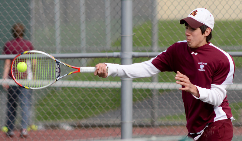 Lockport's Jose Martinez plays doubles with Oliver Carroll, Tuesday, March 27 during a quad tournament at Lockport Township High School. photo for 22nd Century Media by Jean Lachat