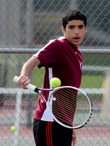 Lockport's Ed Estrella plays doubles with Jonathon Kamba , Tuesday, March 27 during a quad tournament at Lockport Township High School. photo for 22nd Century Media by Jean Lachat