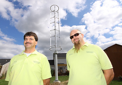 5oct09 bishop--- CINDY STORY GREEN ENERGY Vince Ragnoni and his brother-in-law Michael Townsley are part of the family business that installed what is believed to be the first resecential wind turbine in Lorain County. They own IC Green Energy LLC. They are posing in front of the turbine at Michael's home in Lagrange twp.