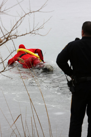 As the first emergency worker entered the water the ice broke under the weight of his body. He had to repeatedly try and lift his body out of the water onto the ice surface. In the beginning the ice kept breaking and he would re-enter the water hampering his attempts to reach the men.